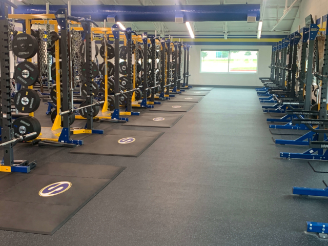 Sunnyvale High School weight room upgrade with all-rubber custom weightlifting platforms and logos