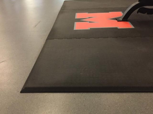 Mineola High School weight room custom weightlifting platforms with custom logos upgrade.